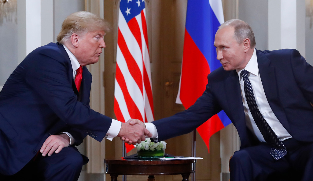 . U.S. President Donald Trump, left, and Russian President Vladimir Putin, right, shake hand at the beginning of a meeting at the Presidential Palace in Helsinki, Finland, Monday, July 16, 2018. (AP Photo/Pablo Martinez Monsivais)