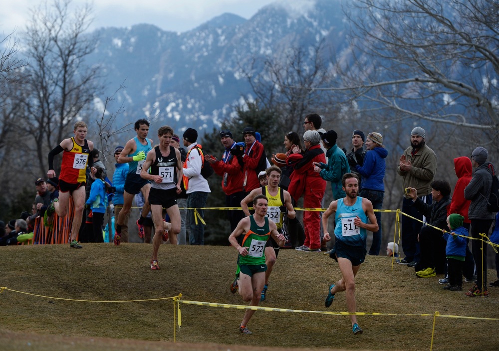 . Chris Derrick, bottom right, leads a pack down hill on course at the USA Cross Country Championships at the Flatirons Golf Course Saturday afternoon, February 15, 2013. Derrick went on to win the event. (Photo By Andy Cross / The Denver Post)