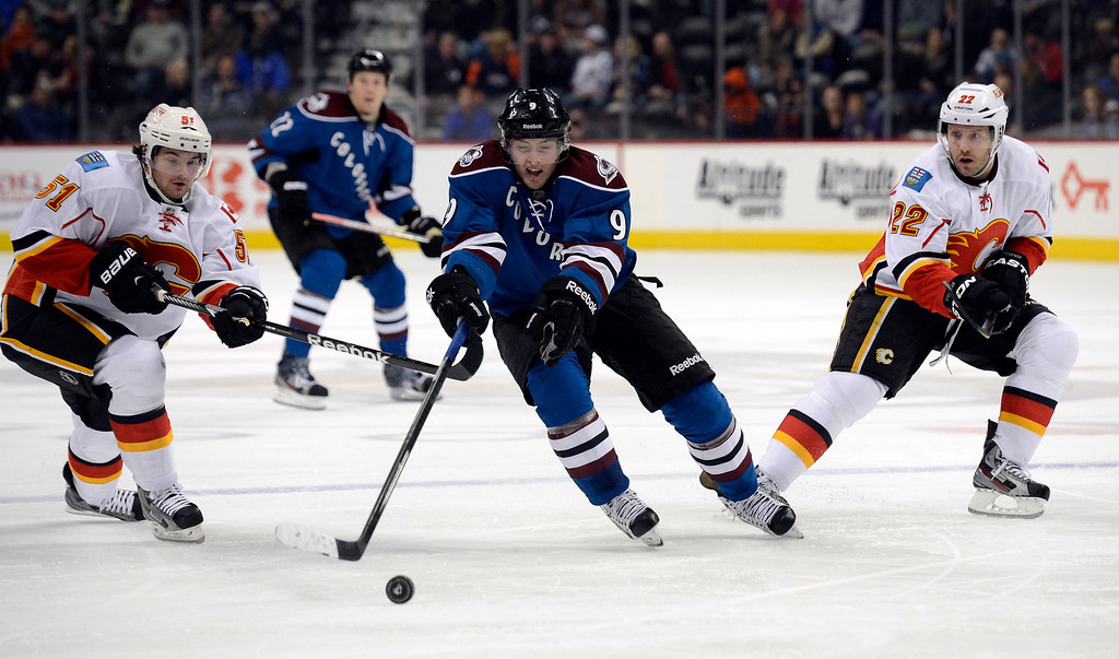 . Matt Duchene (9) of the Colorado Avalanche loses control of the puck between Roman Horak (51) of the Calgary Flames and Lee Stempniak (22) of the Calgary Flames during the first period April 8, 2013 at Pepsi Center. (Photo By John Leyba/The Denver Post)