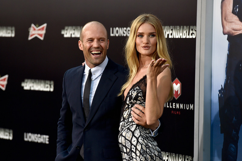 ". Actor Jason Statham and model Rosie Huntington-Whiteley attend Lionsgate Films\' ""The Expendables 3\"" premiere at TCL Chinese Theatre on August 11, 2014 in Hollywood, California.  (Photo by Frazer Harrison/Getty Images)"