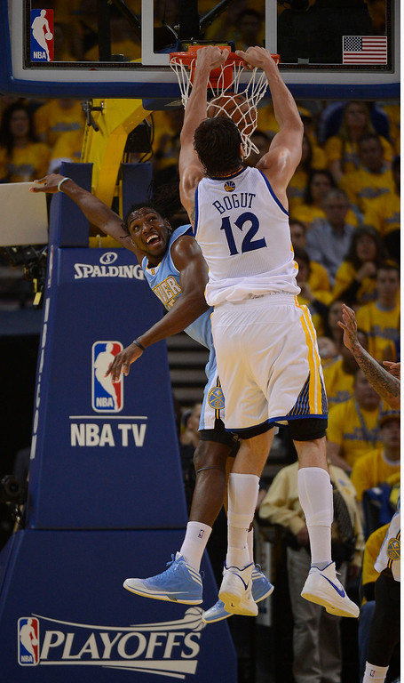 . OAKLAND, CA - APRIL 28:Andrew Bogut (12) of the Golden State Warriors goes up for a big dunk over Kenneth Faried (35) of the Denver Nuggets in the first quarter  in Game 3 of the first round NBA Playoffs April 28, 2013 at Oracle Arena. (Photo By John Leyba/The Denver Post)