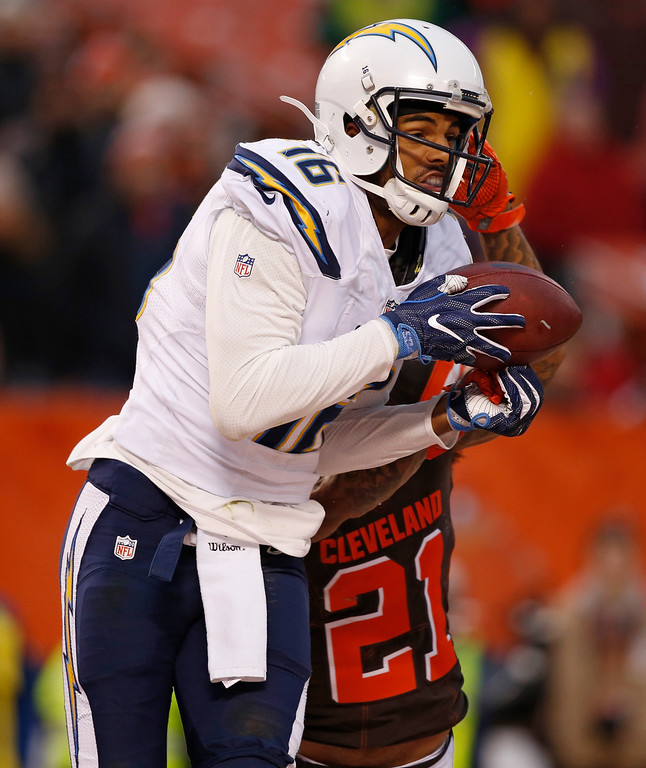. Cleveland Browns cornerback Jamar Taylor (21) breaks up a pass to San Diego Chargers wide receiver Tyrell Williams (16) in the second half of an NFL football game, Saturday, Dec. 24, 2016, in Cleveland. (AP Photo/Ron Schwane)