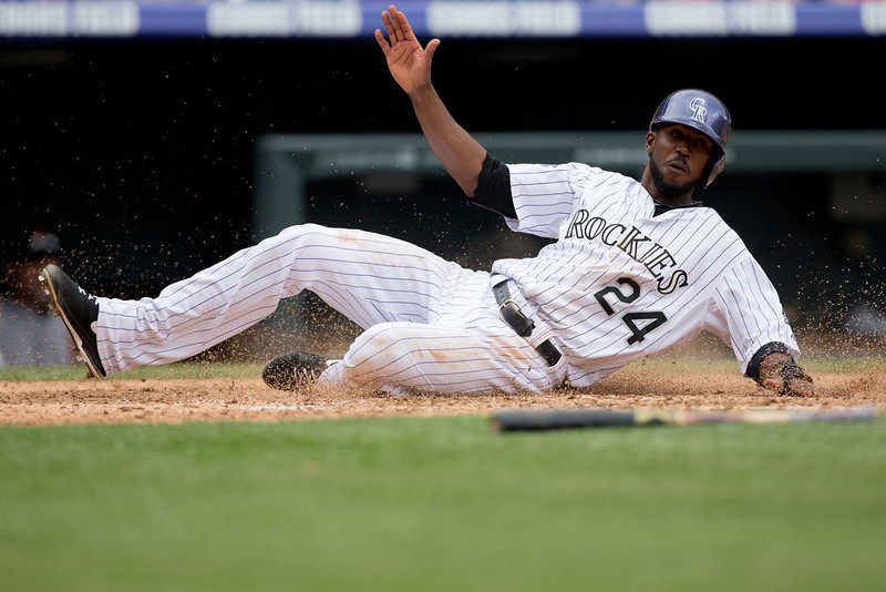 . Dexter Fowler #24 of the Colorado Rockies scores during the fifth inning against the San Francisco Giants at Coors Field on May 19, 2013 in Denver, Colorado.  The Rockies defeated the Giants 5-0.  (Photo by Justin Edmonds/Getty Images)