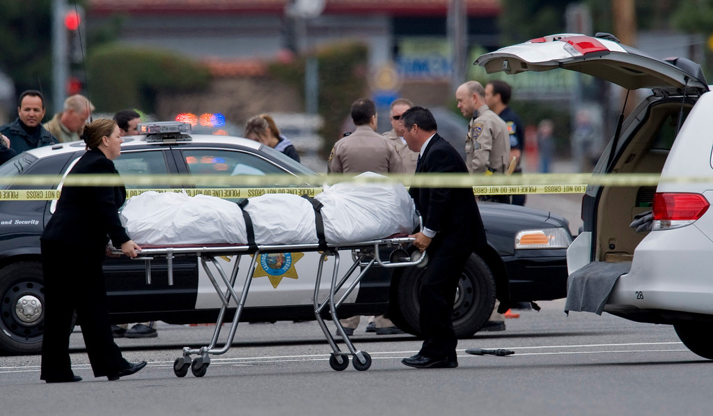 . The Orange County coroner\'s office wheels a body to a waiting van in Orange, Calif., Tuesday, Feb. 19, 2013. (AP Photo/The Orange County Register, Mark Rightmire)