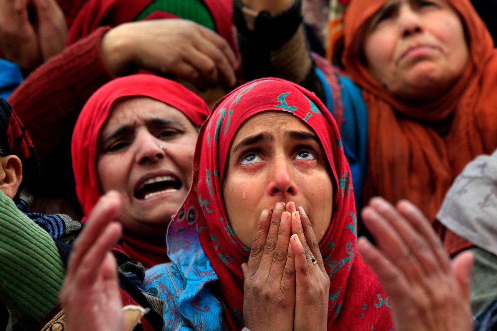 . Tears roll down the cheeks of a Kashmiri Muslim woman as the head priest, unseen, displays a relic of Prophet Muhammad at the Hazratbal shrine on Eid-e-Milad, the birth anniversary of the prophet, in Srinagar, India, Tuesday, Jan. 14, 2014. Thousands of Kashmiri Muslims gathered at the Hazratbal shrine, which houses a relic believed to be a hair from the beard of the prophet. (AP Photo/Dar Yasin)