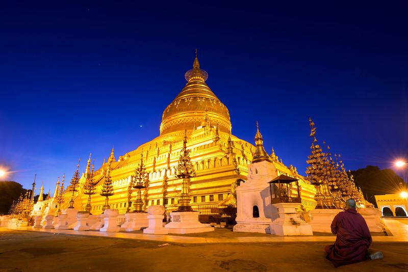 A monk deep in prayer long before sunrise.  Bagan, Myanmar