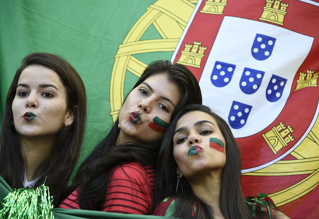 . Portugal fans pose prior to the Group G football match between Germany and Portugal at the Fonte Nova Arena in Salvador during the 2014 FIFA World Cup on June 16, 2014.   ODD ANDERSEN/AFP/Getty Images