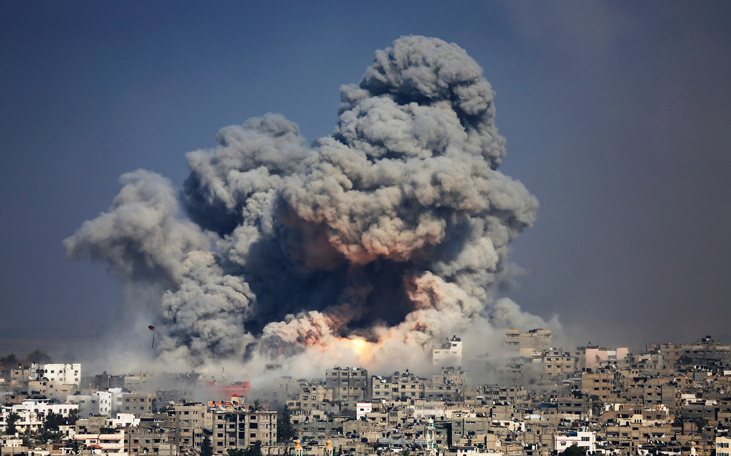 . Smoke and fire from the explosion of an Israeli strike rise over Gaza City,  Tuesday, July 29, 2014.  (AP Photo/Hatem Moussa, File)
