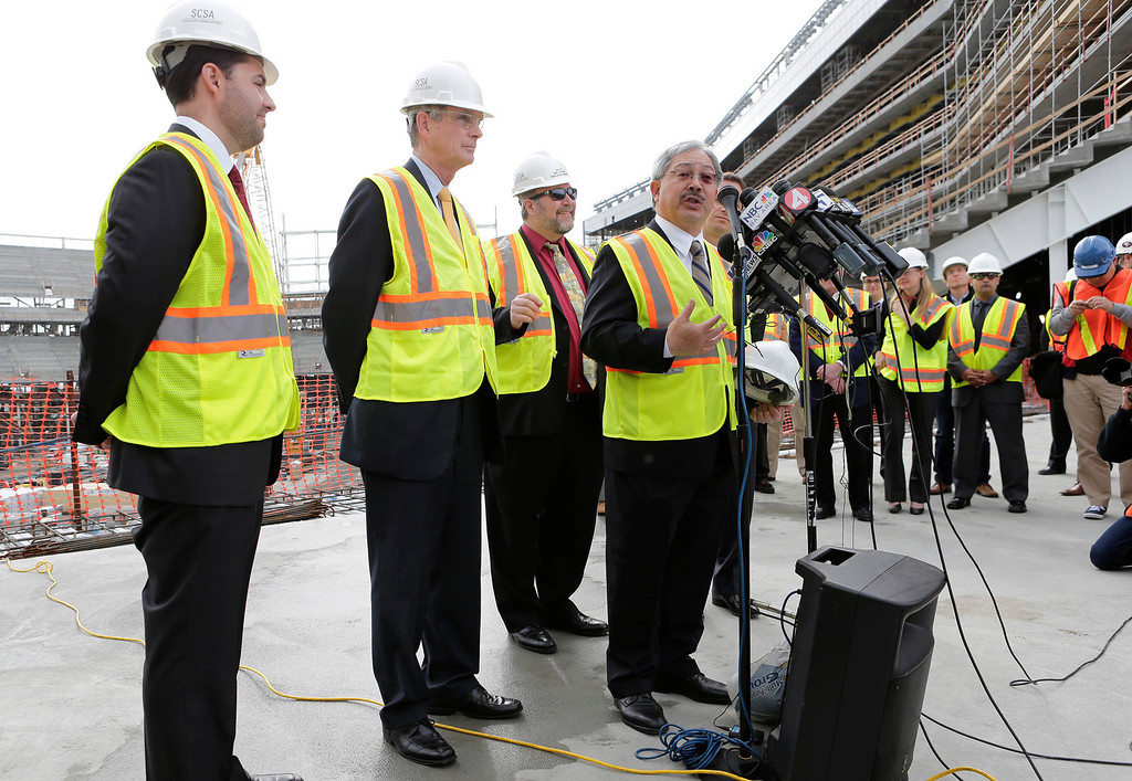 . Ed Lee, San Francisco mayor addresses the media during a press conference at the construction site of the new 49ers stadium in Santa Clara, Calif. on Wednesday, March 6, 2013. From left is Jed York, 49ers CEO, Chuck Reed, San Jose Mayor and Jamie Matthews, Santa Clara mayor, at rear. The Super Bowl Host Committee is competing against Miami for the bragging rights of hosting the 50th Super Bowl in 2016.  (Gary Reyes/ Staff)
