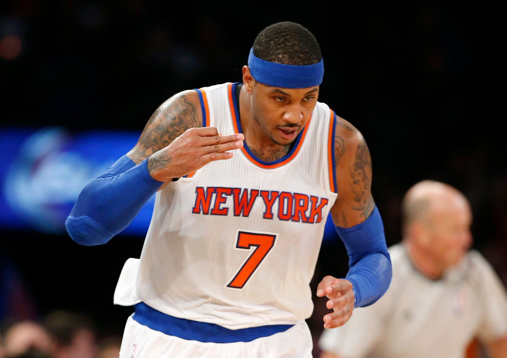 . New York Knicks forward Carmelo Anthony (7) salutes the crowd after hitting a 3-point basket in the first half of an NBA basketball game against the Denver Nuggets in New York, Sunday, Nov. 16, 2014. The Knicks defeated the Nuggets 109-93. (AP Photo/Kathy Willens)