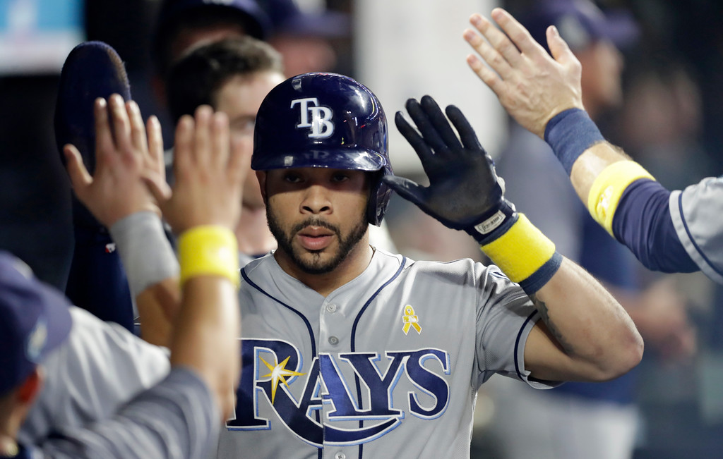 . Tampa Bay Rays\' Tommy Pham is congratulated by teammates after scoring in the sixth inning of a baseball game against the Cleveland Indians, Saturday, Sept. 1, 2018, in Cleveland. (AP Photo/Tony Dejak)