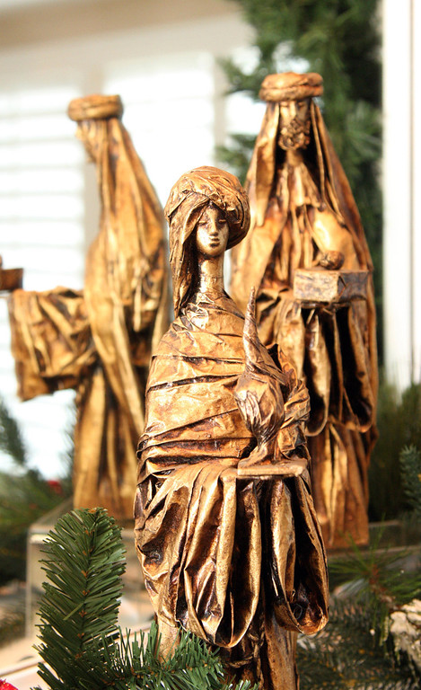 . A Nativity scene from Mexico is displayed on the living room fireplace mantel in Gladys Young\'s Danville, Calif., home on Wednesday, Nov. 28, 2012. She decorates many of the rooms with a variety of themes.  (Jim Stevens/Staff)