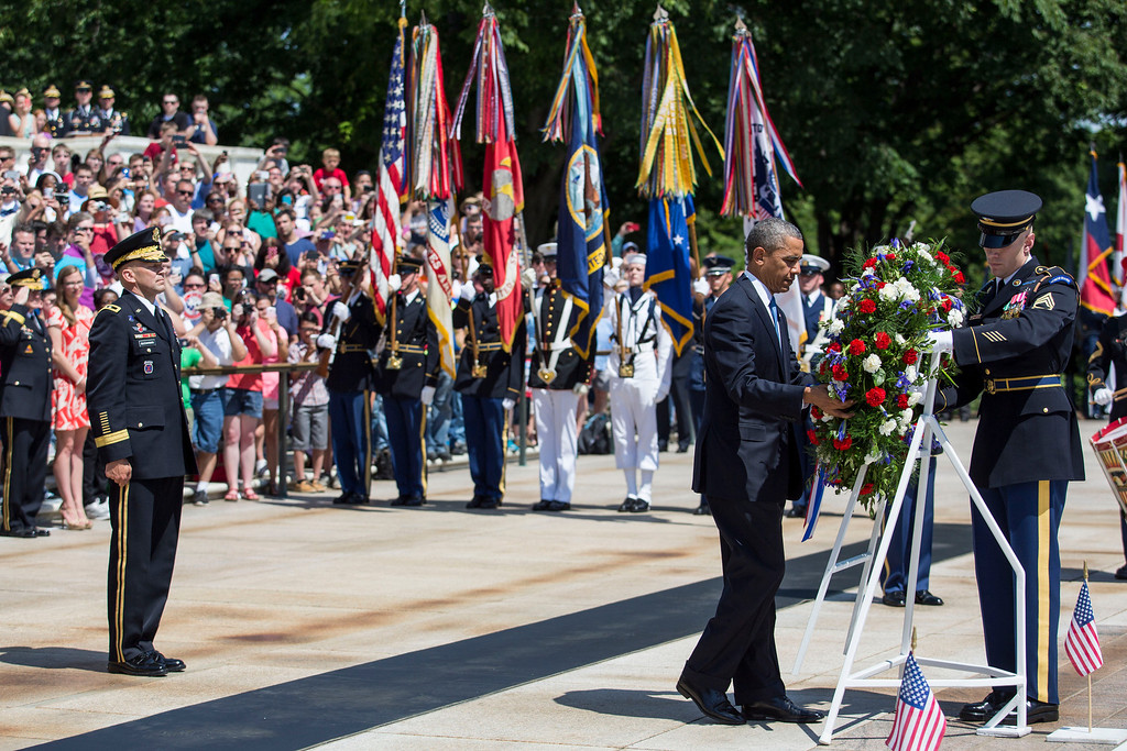. U.S. President Barack Obama lays a wreath at the Tomb of the Unknown Soldier at Arlington National Cemetery, May 26, 2014 in Arlington, Virginia. Obama returned to Washington the morning  of May 26, after a surprise visit to Afghanistan to visit U.S. troops at Bagram Air Field. (Pool photo by Drew Angerer/Getty Images)