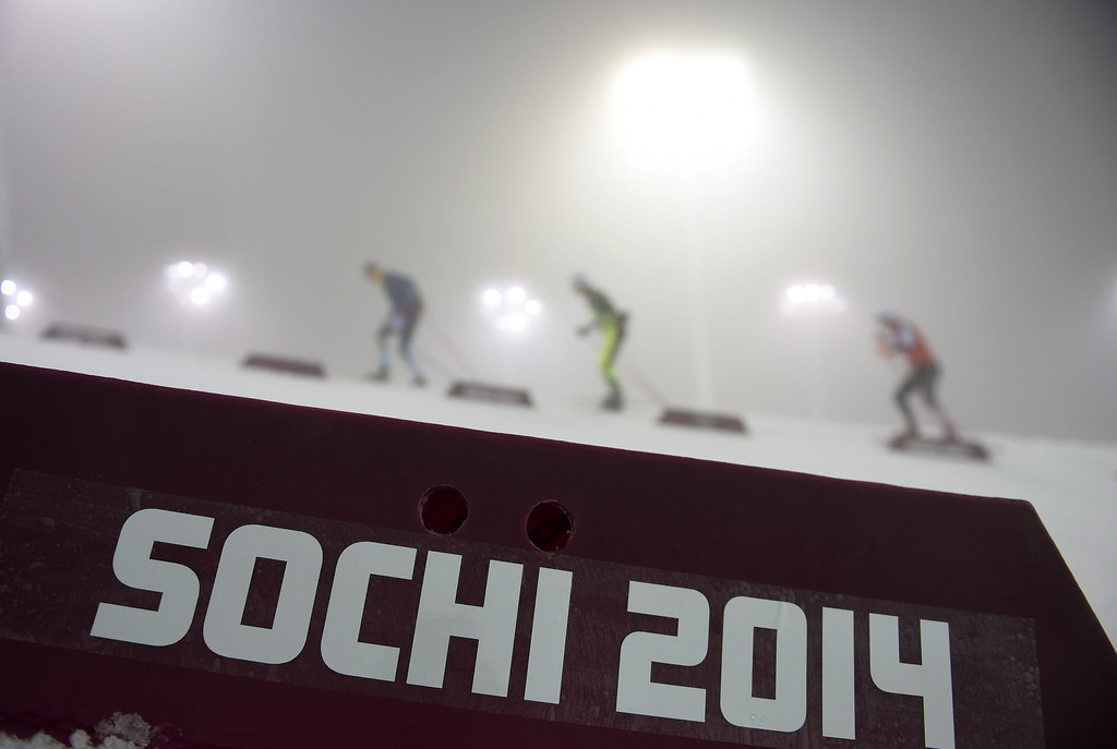 . Athletes warm up in heavy fog prior to the Men\'s Biathlon 15km competition at Laura Cross Country and Biathlon Center at the Sochi 2014 Olympic Games, Krasnaya Polyana, Russia, 16 February 2014. Men\'s 15km mass start has been postponed to Monday, 17 February it was announced.  EPA/HENDRIK SCHMIDT