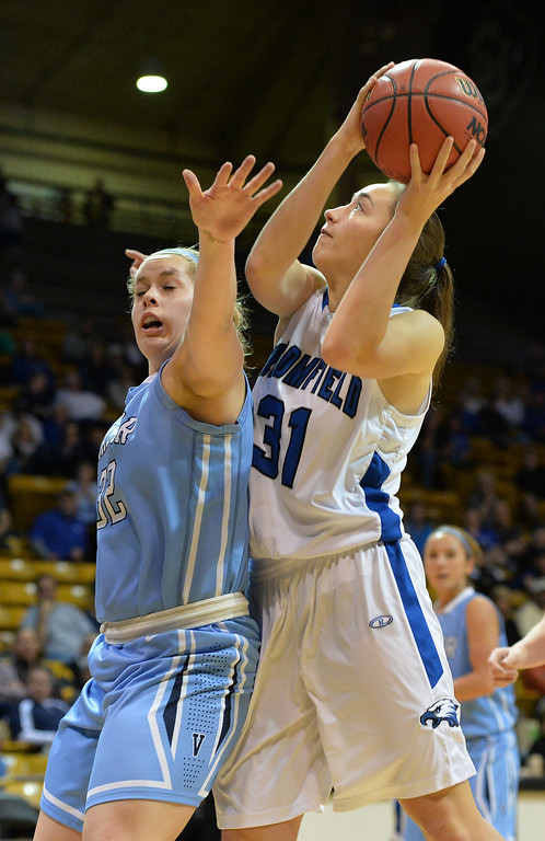 . Broomfield\'s Brenna Fankell goes to the basket  against Valor Christian\'s Kendall Bradbury during the final four 4A state game at Coors Event Center. (David R. Jennings/Broomfield Enterprise)