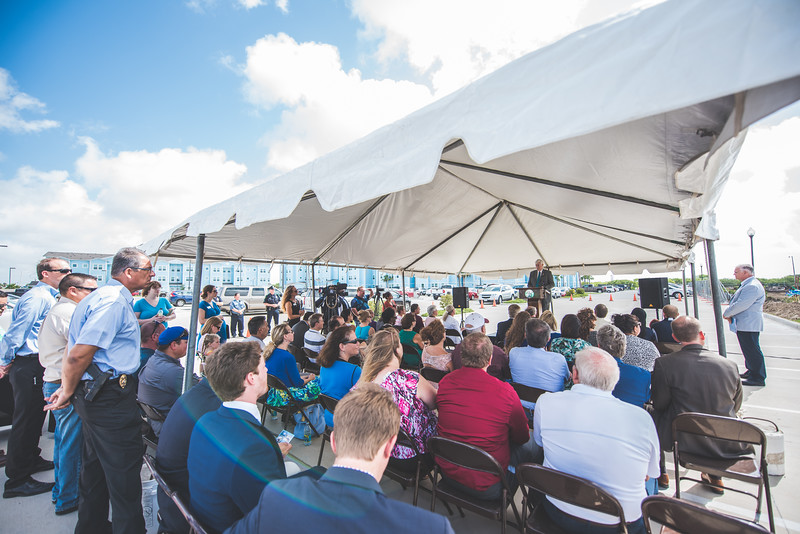 Flavius Killebrew welcomes guests to the Momentum Village phase 2 ground breaking ceremony.