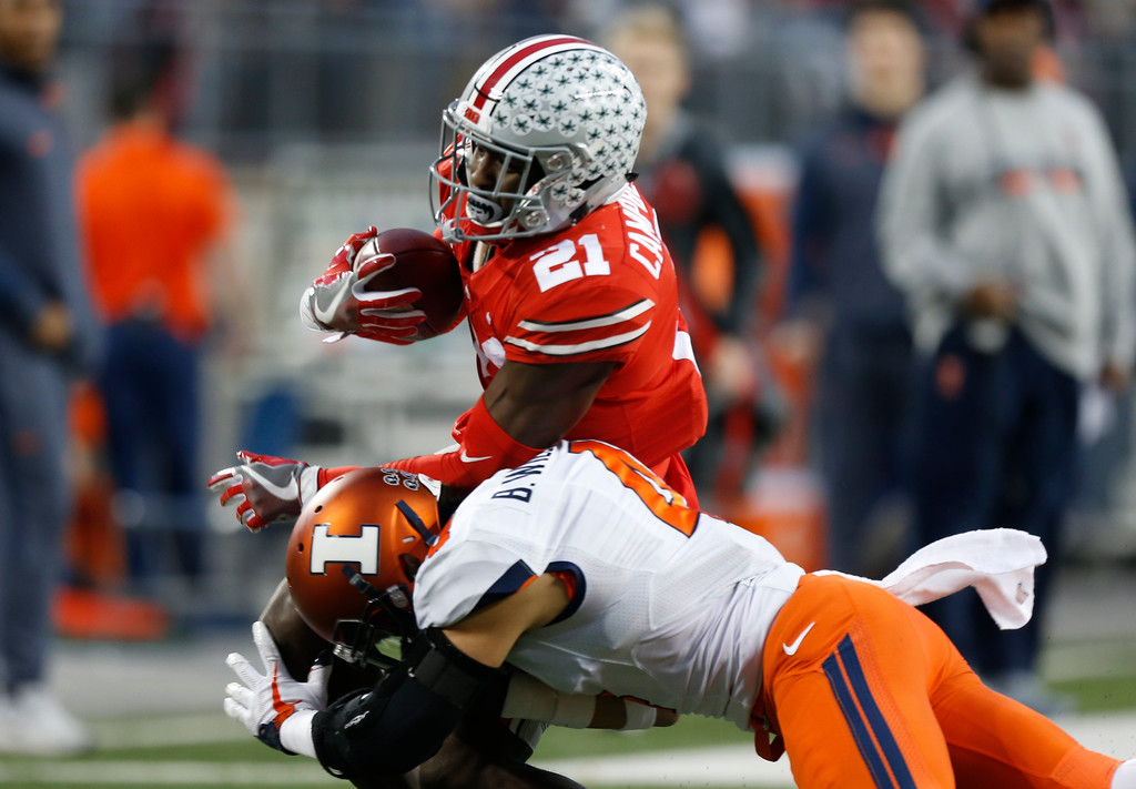 . Illinois defensive back Bennett Williams, bottom, tackles Ohio State receiver Parris Campbell during the first half of an NCAA college football game Saturday, Nov. 18, 2017, in Columbus, Ohio. (AP Photo/Jay LaPrete)