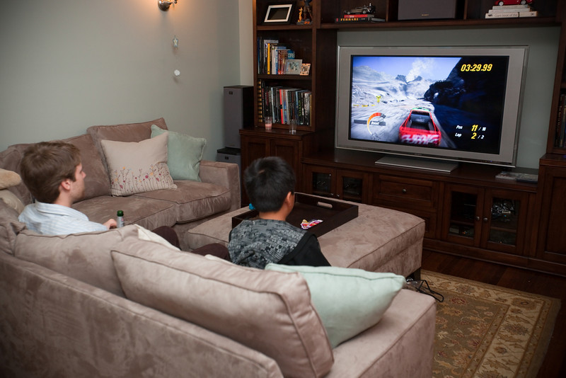 Jesse watches Tommy play Motorstorm: Pacifc Rift on the PS3