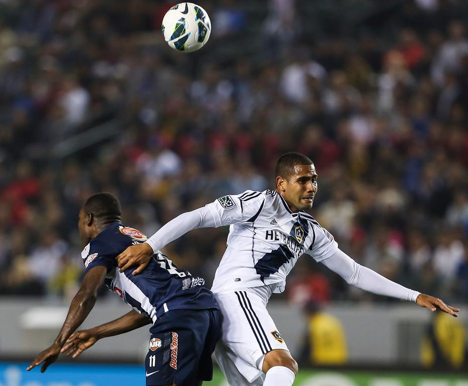 . Los Angeles Galaxy defender Leonardo, right, and Monterrey forward Sergio Santana during the CONCACAF Champions League semifinal, Wednesday, April 3, 2013, in Carson, Calif. Monterrey won 2-1. (AP Photo/Bret Hartman)