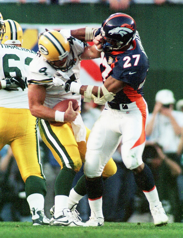 . Caption: Denver Broncos Steve Atwater wraps up Green Bay Packers  Brett Favre for a sack during the second half of Super Bowl XXXII.  (John Leyba/The Denver Post)