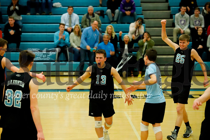 Caleb Dawson (13) celebrates a point with teammates in Seneca's playoff win over Baldwin. Seb Foltz/Butler Eagle