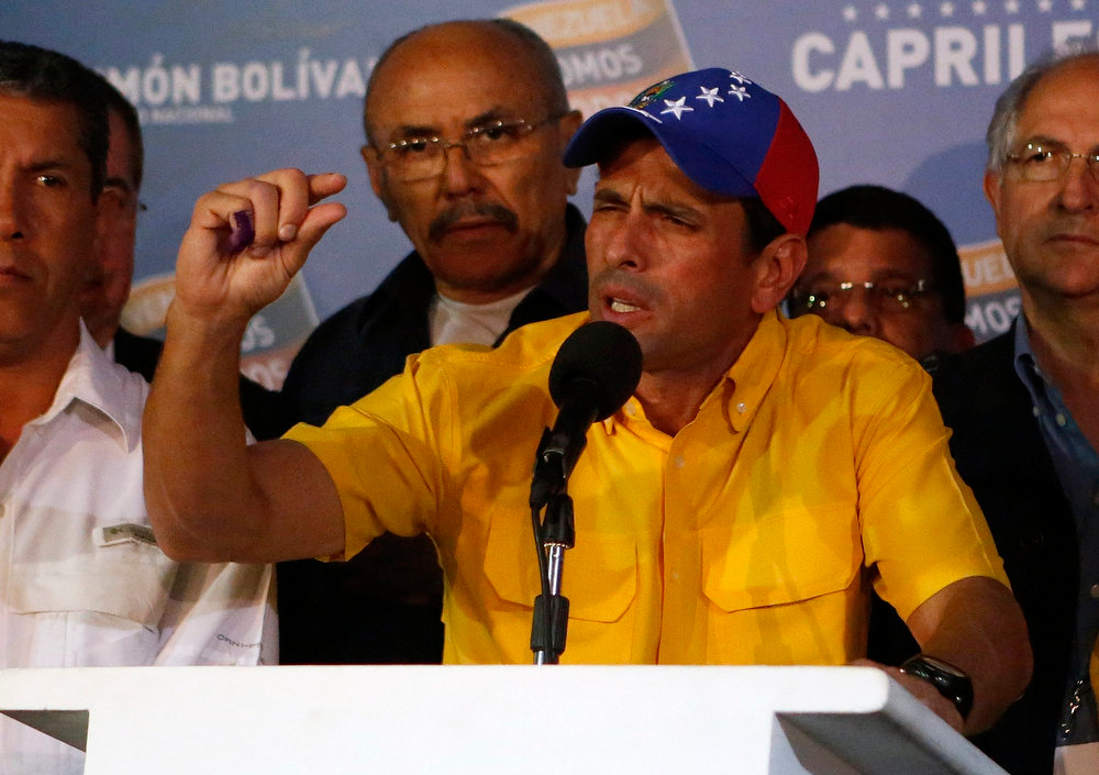 . Venezuela\'s opposition leader Henrique Capriles gestures during a news conference in Caracas April 15, 2013. Capriles refused on Monday to accept ruling party candidate Nicolas Maduro\'s narrow election victory and demanded a recount. REUTERS/Marco Bello