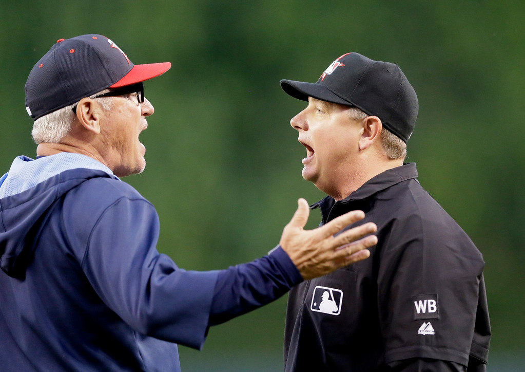 . Tampa Bay Rays manager Joe Maddon, left, argues with second base umpire Greg Gibson during the sixth inning of a baseball game against the Detroit Tigers in Detroit, Friday, July 4, 2014. (AP Photo/Carlos Osorio)