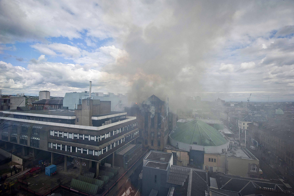 . Smoke rises into the sky as fire crews tackle a fire at Glasgow School of Art Charles Rennie Mackintosh Building on May 23, 2014 in Glasgow, Scotland. T  (Photo by Chris Watt/Getty Images)