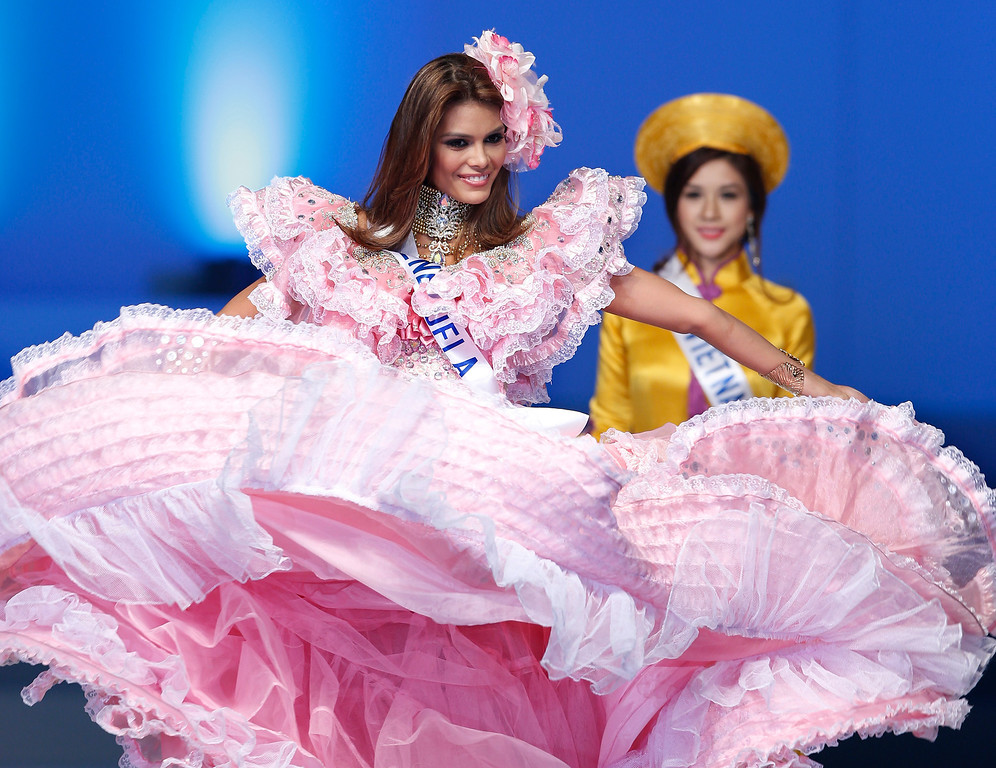 . Miss Venezuela Nicelin Elian Herrera walks with a national dress during the final of the 53rd Miss International Beauty Pageant in Tokyo Tuesday, Dec. 17, 2013. (AP Photo/Shizuo Kambayashi)