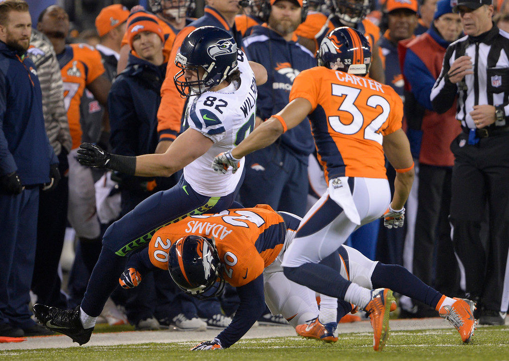 . Denver Broncos free safety Mike Adams (20) hits Seattle Seahawks tight end Luke Willson (82) during the third quarter. The Denver Broncos vs the Seattle Seahawks in Super Bowl XLVIII at MetLife Stadium in East Rutherford, New Jersey Sunday, February 2, 2014. (Photo by Joe Amon/The Denver Post)