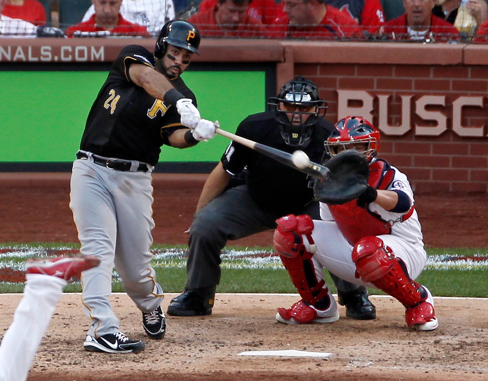 . Pittsburgh Pirates\' Pedro Alvarez (24) hits a solo home run against the St. Louis Cardinals in the fifth inning of Game 1 of baseball\'s National League division series on Thursday, Oct. 3, 2013, in St. Louis. Catching for the Cardinals is Yadier Molina. (AP Photo/Sarah Conard)