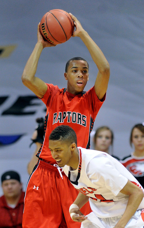 . BOULDER, CO. - MARCH 16: Raptors senior forward Rayjon Craig (1) came down with a rebound in the first half. The Denver East High School boy\'s basketball team met Eaglecrest in the 5A championship game Saturday, March 16, 2013 at the Coors Events Center in Boulder.  (Photo By Karl Gehring/The Denver Post)