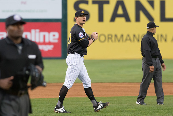 05/03/19 Wesley Bunnell | Staff The New Britain Bees home opener vs the Somerset Patriots on Friday night at New Britain Stadium. Starting pitcher Christian Friedrich (23) rubs a new ball as he walks back to the mound.