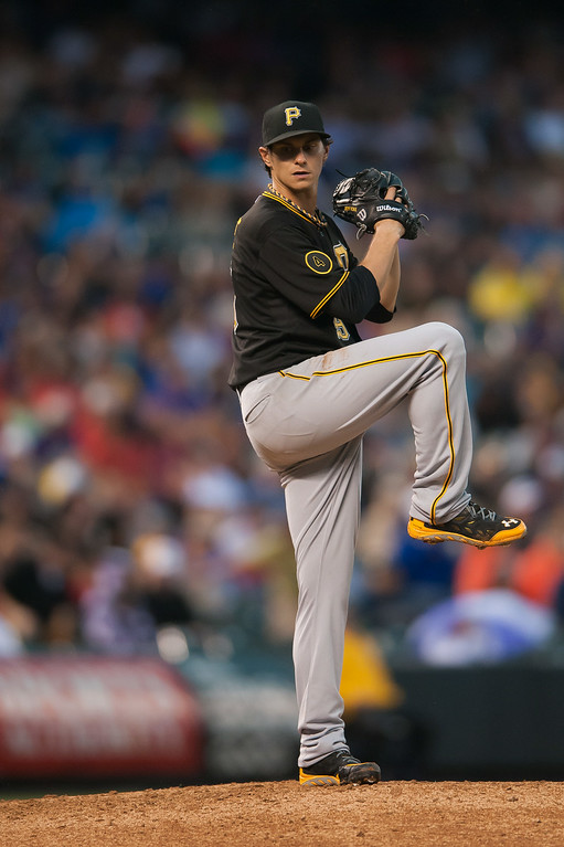 . Jeff Locke #49 of the Pittsburgh Pirates pitches against the Colorado Rockies during a game at Coors Field on July 26, 2014 in Denver, Colorado.  (Photo by Dustin Bradford/Getty Images)