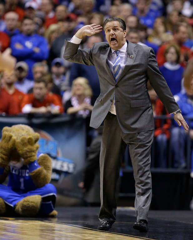 . Kentucky head coach John Calipari reacts during the first half of an NCAA Midwest Regional semifinal college basketball tournament game against the Louisville Friday, March 28, 2014, in Indianapolis. (AP Photo/Michael Conroy)