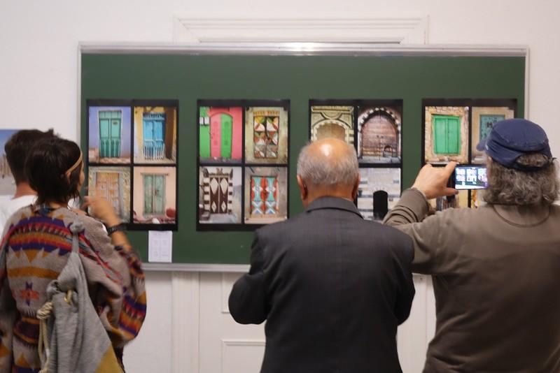 a photo of photos being taken of photos of doors...