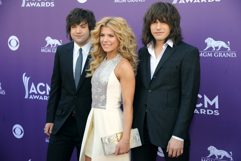 . From left, Neil Perry, Kimberly Perry and Reid Perry, of musical group The Band Perry, arrive at the 48th Annual Academy of Country Music Awards at the MGM Grand Garden Arena in Las Vegas on Sunday, April 7, 2013. (Photo by Al Powers/Invision/AP)