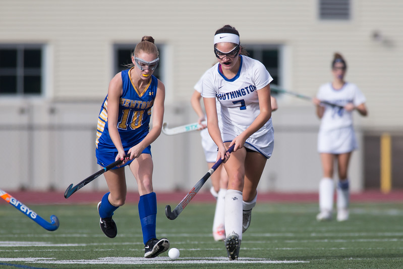 Southington's Jenna Garcia gets past a Newtown's Katherine Trammel Monday during a qualifying round in Class L of the CIAC Tournament at Fontana Field in Southington November 6, 2017 | Justin Weekes / For the Record-Journal