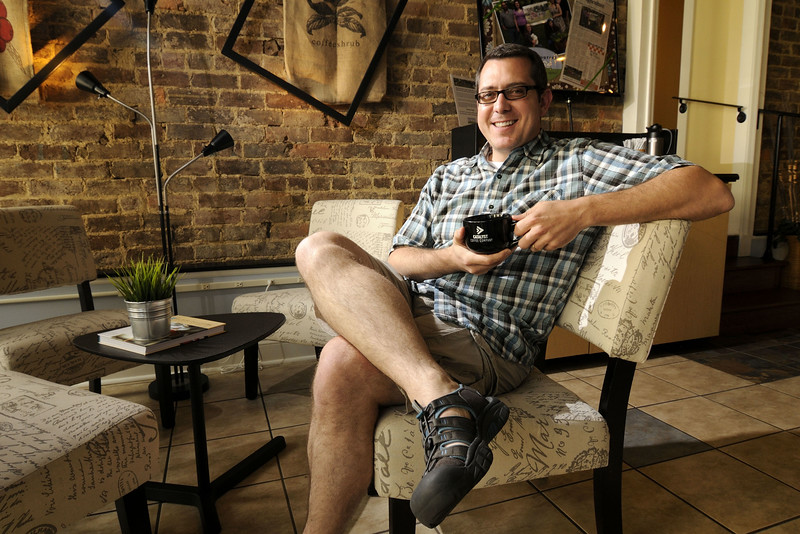 Scott Wakefield, pastor at the local First Christian Church and founder of the Catalyst Coffee Company, sits in a comfortable chair in Greeneville, TN on Friday, June 6, 2014. Copyright 2014 Jason Barnette