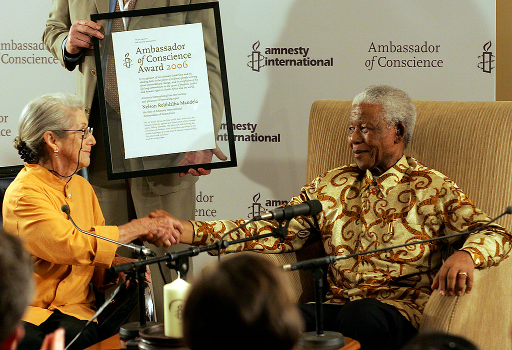 """. Former South African President Nelson Mandela, right, receives the Ambassador of Conscience Award from Nobel Prize winning-author Nadine Gordimer, left, at the Nelson Mandela Foundation in Johannesburg, South Africa, Wednesday, Nov. 1, 2006. Gordimer described Mandela as one of the greatest men of the 20 century and a man who through his leadership and dedication to justice and equality had put morality back into government. \""""Like Amnesty International, I have struggled for justice and human rights for long years,\"""" said Mandela when he accepted the award. (AP Photo/Themba Hadebe)"""