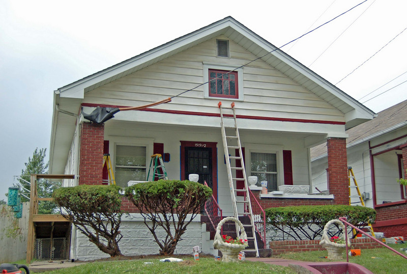 Work in progress on facade.  Vinyl cleaned in front gable.  Foudation prepped and primed.  Shrubs trimmed (heavily).  Side ramp powerwashed.  Trim work on the porch prepped and primed and ready for paint.  Flowers planted out front.