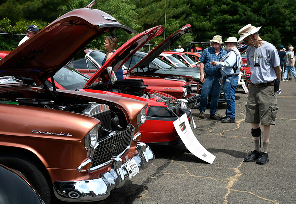 6/9/2018 Mike Orazzi | Staff Edwin Colasanto admires cars on display during the 7th Annual Fly-In Car Show held at Robertson Airport in Plainville Saturday.