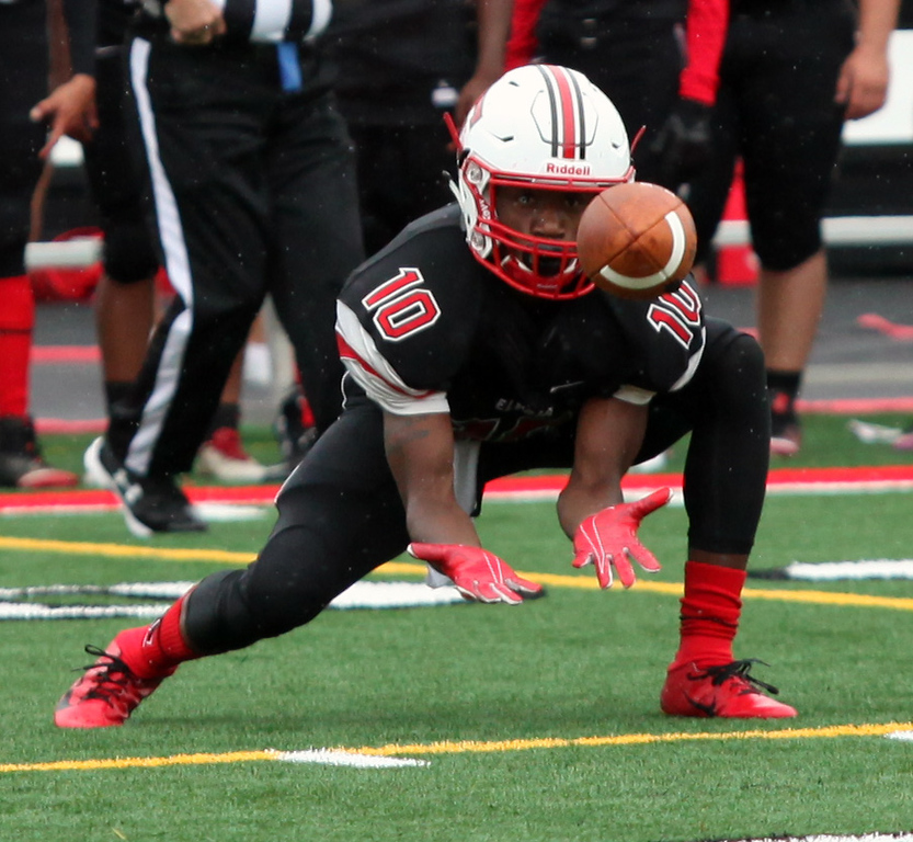 . Randy Meyers - The Morning Journal<br> Elyria\'s Adaveon Drummer looks in a low pass for a reception against Lorain during the first quarter on Sept. 8.