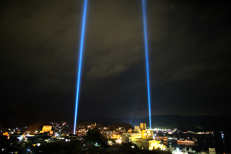 . Kesennuma city is seen during a lightshow on March 11, 2013 in Kesennuma, Japan. Japan is commemorating the second anniversary of the 2011 Magnitude 9.0 earthquake and subsequent tsunami that claimed more than 18,000 lives.  (Photo by Athit Perawongmetha/Getty Images)