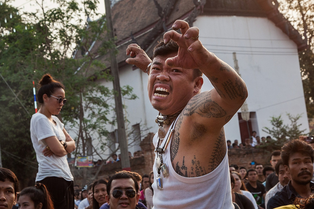 . A Thai devotee reportedly possessed by spirits growls during the celebration of the annual Tattoo festival at Wat Bang Phra on March 15, 2014 in Nakhon Pathom, Thailand.  (Photo by Omar Havana/Getty Images)