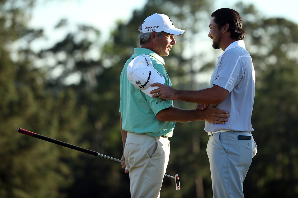 . AUGUSTA, GA - APRIL 13:  Fred Couples (L) of the United States shakes hands with Jason Day of Australia after completing the third round of the 2013 Masters Tournament at Augusta National Golf Club on April 13, 2013 in Augusta, Georgia.  (Photo by Andrew Redington/Getty Images)