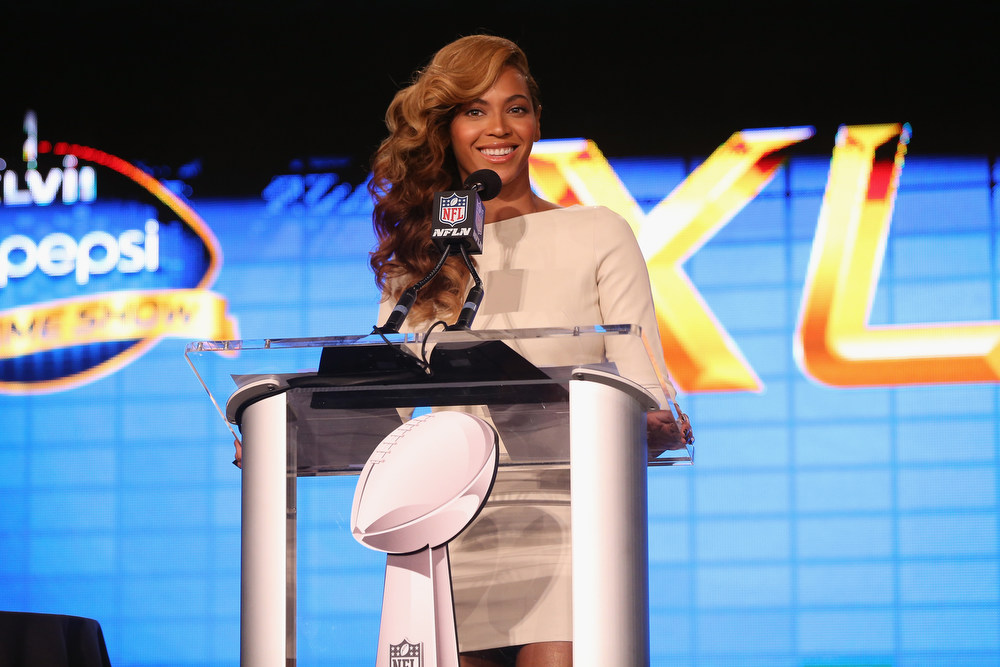 Description of . Beyonce speaks at the Pepsi Super Bowl XLVII Halftime Show Press Conference at the Ernest N. Morial Convention Center on January 31, 2013 in New Orleans, Louisiana.  (Photo by Christopher Polk/Getty Images)