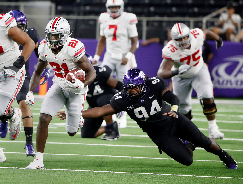 . Ohio State wide receiver Parris Campbell (21) runs for a touchdown as TCU defensive tackle Corey Bethley (94) fails on a tackle attempt during the second half of an NCAA college football game in Arlington, Texas, Saturday, Sept. 15, 2018. (AP Photo/Michael Ainsworth)