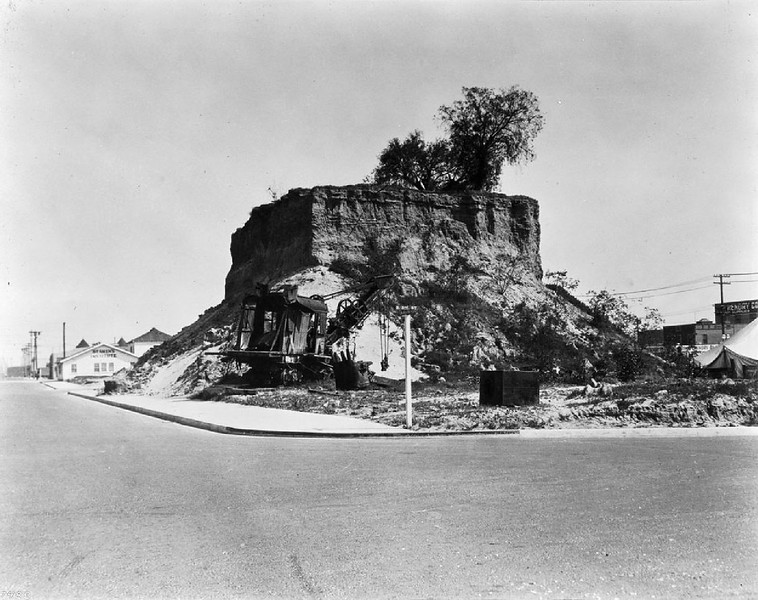 Hill being removed at the intersection of East Third Street and Beacon Street in San Pedro, Los Angeles, ca.1920