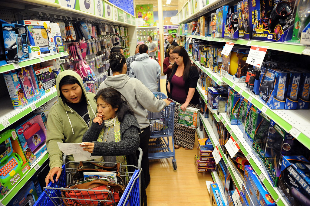 . Shoppers search for deals at Toys�R�Us after the store opened their doors at 5:00 PM on Thanksgiving November 26, 2013 in Porter Ranch, CA.  Many retailers opened their doors with deals starting on Thanksgiving rather than on the traditional Black Friday.(Andy Holzman/Los Angeles Daily News)